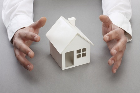 Hands and house model. Real property or insurance concept Stock Photo - 8876841