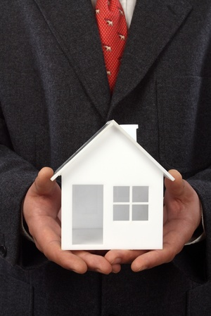 House model in hand. Real property or insurance concept