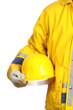personal protective equipment: man holding yellow helmet over white