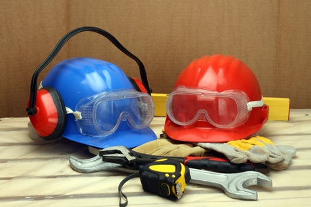 health dangers: Two workers helmets close up. Safety concept