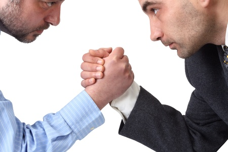 business disagreement: Arm wrestling in the office isolated on white background.  Stock Photo