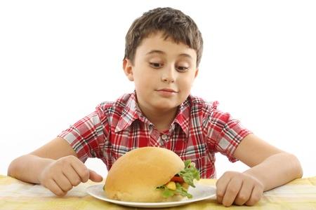 boy eating a big hamburger close up Stock Photo - 9074567
