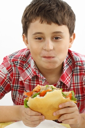 boy eating a big hamburger close up Stock Photo - 9074573