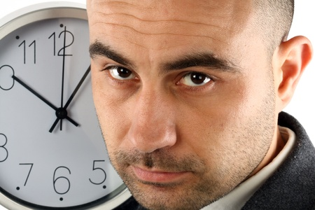Close up portrait of a businessman and clock. Time for work concept photo