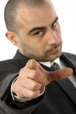 Businessman pointing at the viewer, shallow dof photo