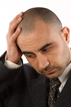 Portrait of businessman with a  headache  over white photo