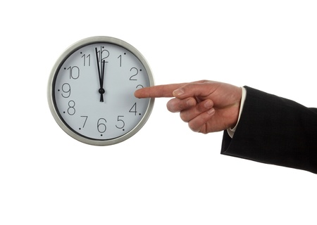 Businessman pointing at  big clock. Time for work concept Stock Photo - 9167080