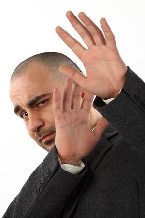 scared businessman on white background  photo