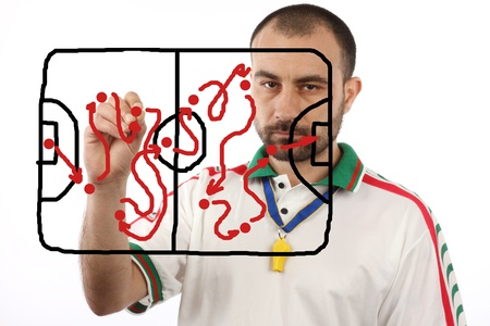 soccer menager drawing a tactical plan photo
