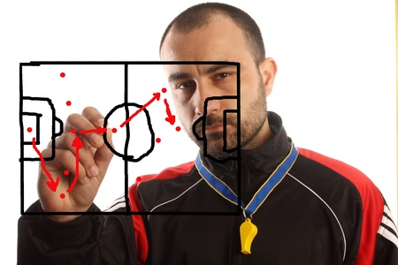 coach: soccer manager drawing a tactical plan