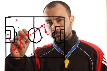 tactics: soccer manager drawing a tactical plan