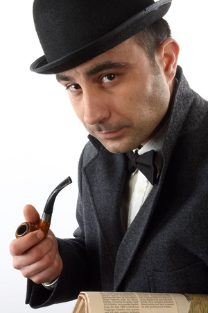 bowler hat: Portrait of a man with a tobacco pipe and hat bowler