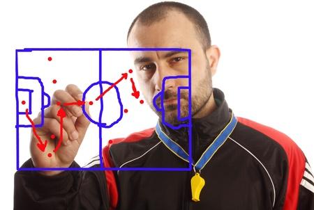 manager di calcio un piano tattico di disegno Archivio Fotografico