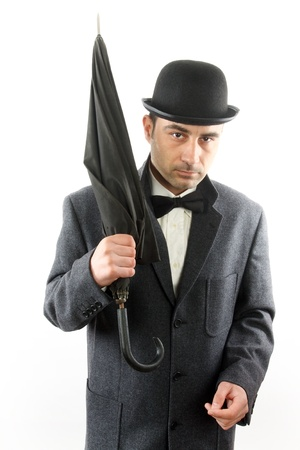 man with bowler hat and an umbrella photo