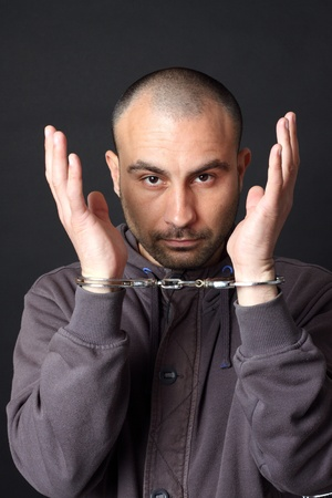 Portrait of a man with handcuffs Stock Photo - 9529069