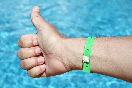 thumbs up sign over water background. Holiday concept Stock Photo - 9744304