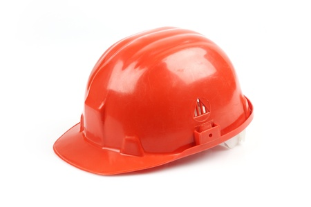 protective wear: Red helmet over white background