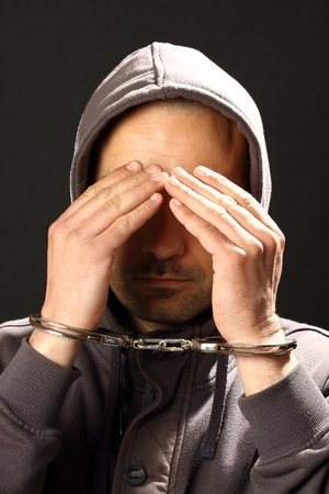 man with handcuffs, hiding his face Stock Photo - 10099983