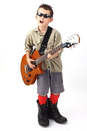 boy playing with a guitar over white Stock Photo