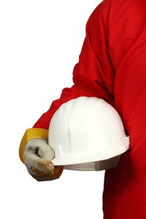 health industry: man holding white  helmet over white background