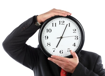 Businessman hiding behind the big clock. Time for work concept Imagens - 10886424