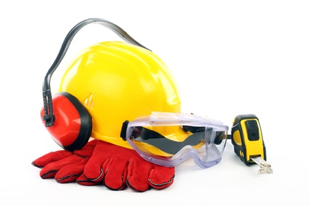 Safety gear kit close up over white  Imagens