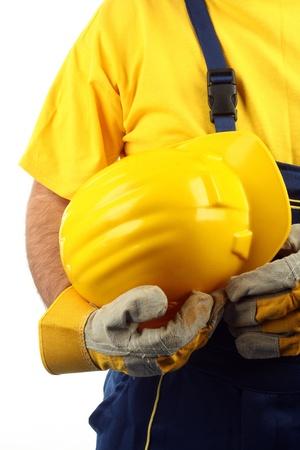 man holding yellow helmet over white Imagens