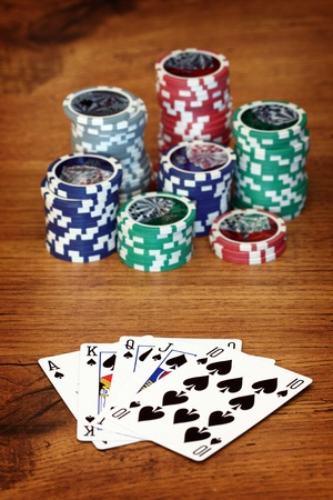 Playing poker concept. Stack of chips and playing cards photo