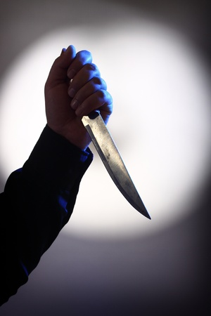 stabbing: The hand of assassin is holding the knife  Stock Photo