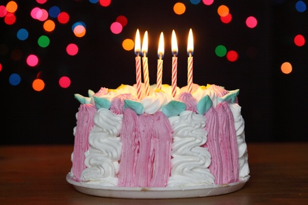 birthday cake with candles over black background