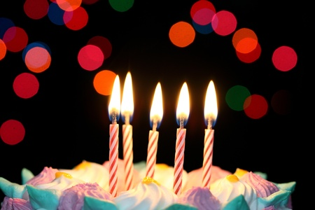 birthday food: Some lit birthday candles close up  Stock Photo