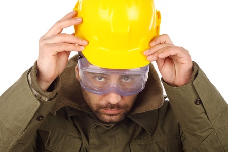 worker with yellow helmet over white  photo
