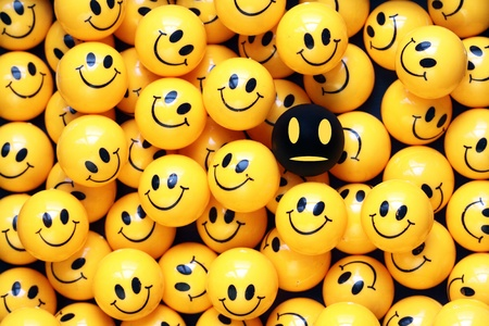 heap of yellow balls with smiley faces