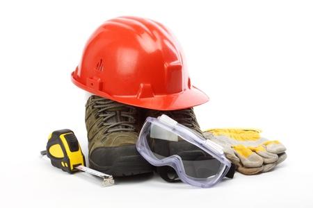 Veiligheid gear kit van dichtbij over white Stockfoto