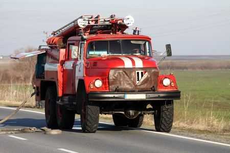 Red Fire Truck in action on the road