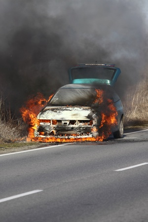 burning car on the road photo