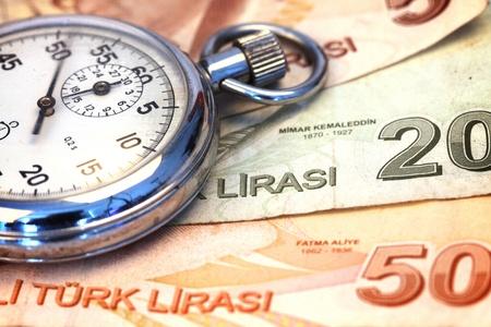 Chronometer and turkish liras bills, close up , shallow dof photo