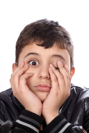 boy with bored expression on face over white Stock Photo