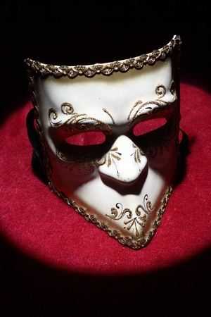 Close up  of carnival mask under the spotlight photo
