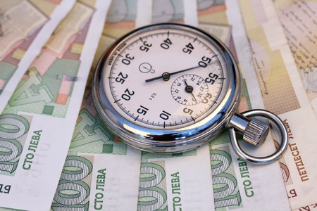 Chronometer and Bulgarian leva  bills, close up , shallow dof photo