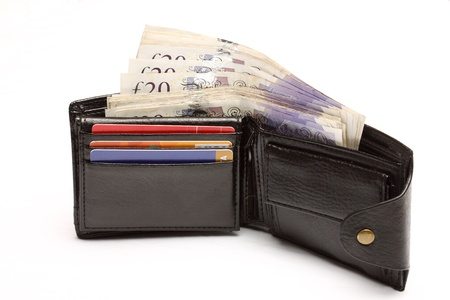 Open leather wallet with cash over white photo