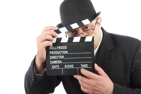 Old fashioned man holding movie clapboard  Stock Photo - 13064454