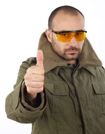 Portrait of men with goggles, thumb up  photo
