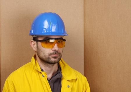 Portrait of worker whit blue helmet photo