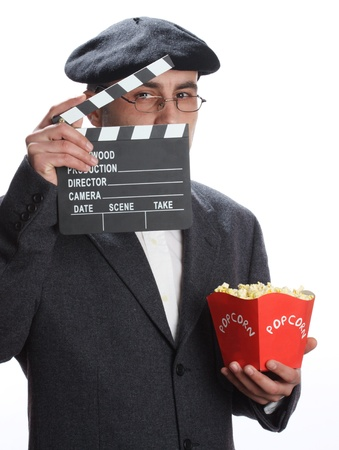 Old fashioned man looking through the movie clapper  photo