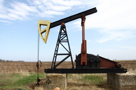 Oil pump jack working in the field Stock Photo - 13242053