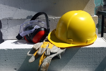 personal protective equipment: Safety gear kit close up on work place Stock Photo
