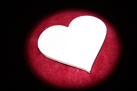 Shape of a heart illuminated by spot. Stock Photo - 13284987
