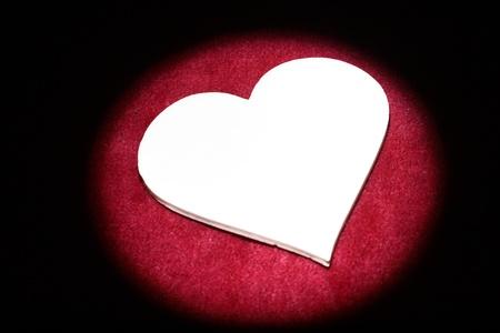 Shape of a heart illuminated by spot. Stock Photo - 13284987