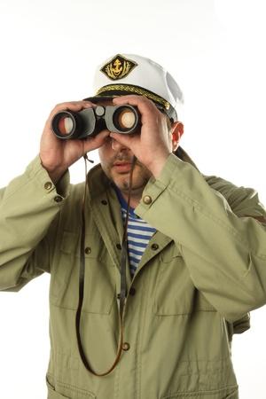 seaman with binoculars over white  photo